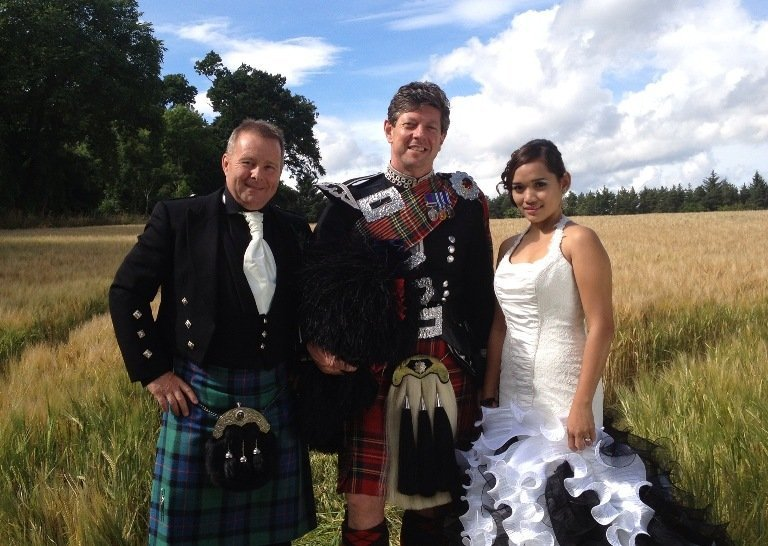 Piper On Parade - Inverness Highlands of Scotland